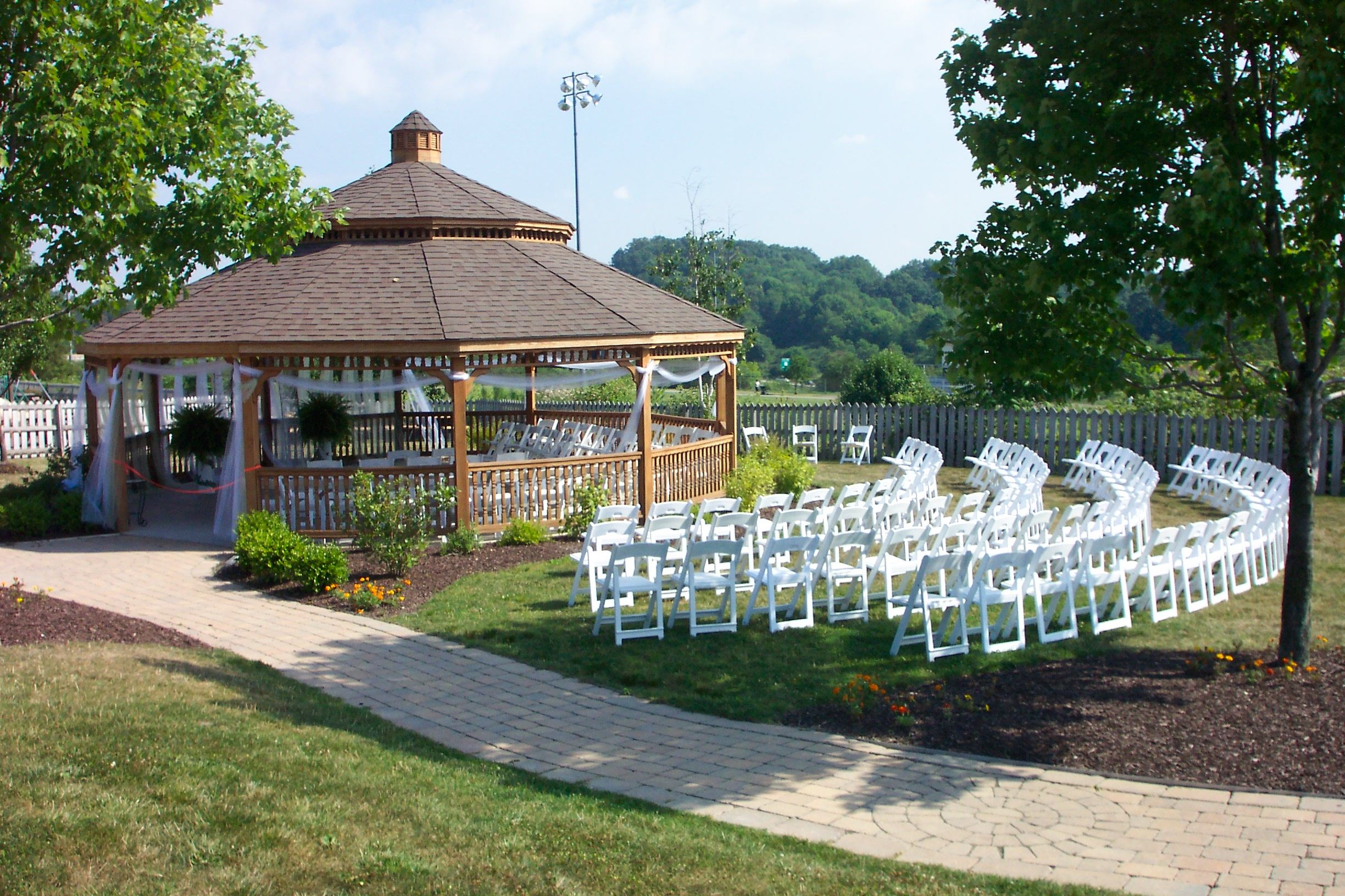 Decorated gazebo with white chairs
